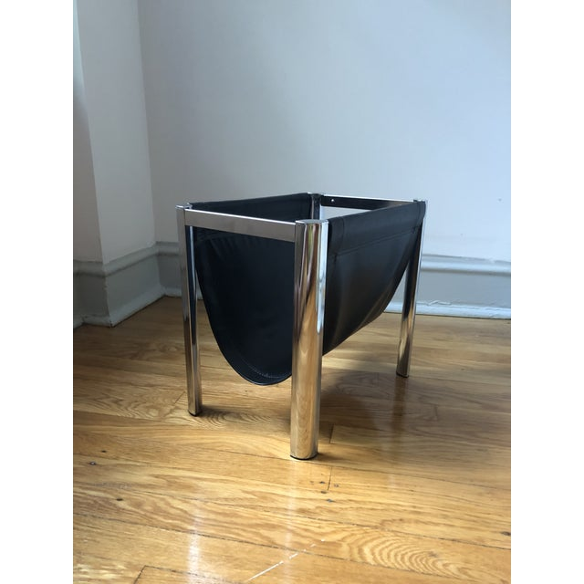 Talk about sex appeal! This magazine holder features a polished chrome frame supporting a black vinyl sling, the legs...