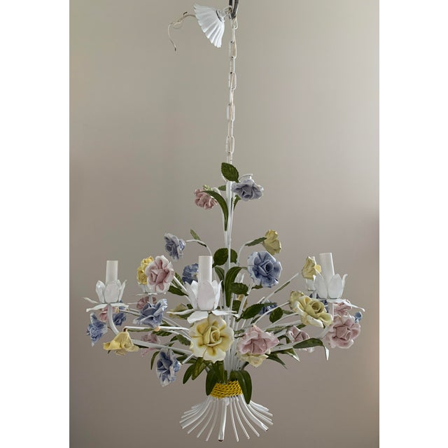 This is a very beautiful Italian painted tole 6 arms chandelier from circa 1955. The whole piece is richly adorned with...