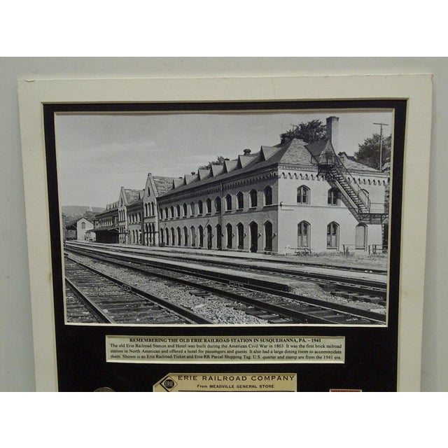 This is an original, matted, multi-media collage of the Erie Railroad Company, 1941. The collage contains -- from the...