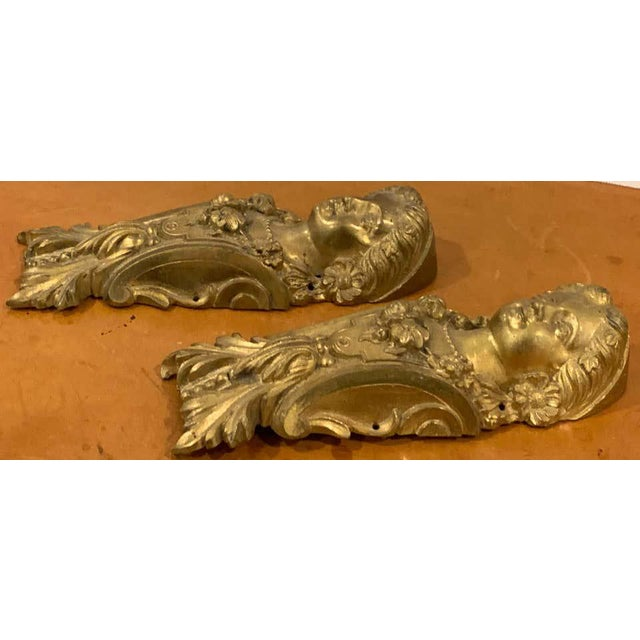 Pair of Napoleon III gilt bronze female medallion furniture mounts, each one finely cast and detailed.