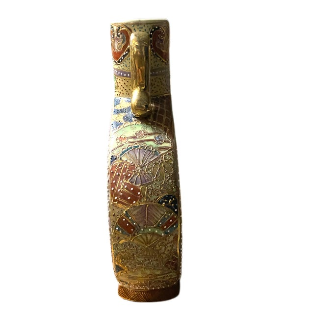 Hand Painted Royal Satsuma Moriage Chinese Handled Vase. Measures over 8 inches. Condition is excellent with no chips or...