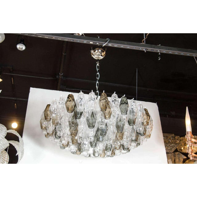 This pair of spectacular Murano glass chandeliers by Venini features numerous hand blown Murano glass polyhedral shades in...