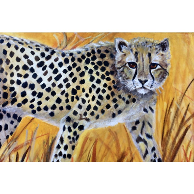 """An original painting of a cheetah in a grassy field, signed by Gillian Levy. Excellent condition. 36"""" x 18"""" x 1"""""""