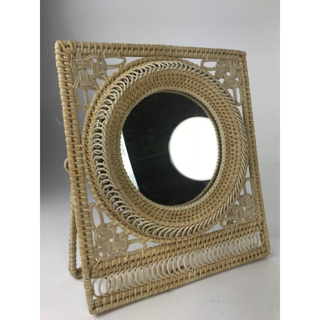 This is a really cute table mirror made out of a wicker fram with an easel stand in the back for easy standing. This...