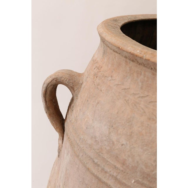 Antique Greek olive jar. Hand-sculpted ribbed amphora in terracotta. Early 20th century.