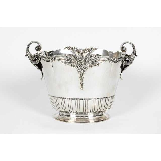 Large antique sterling silver wine cooler with two side handles or barware piece with exterior design details. The barware...