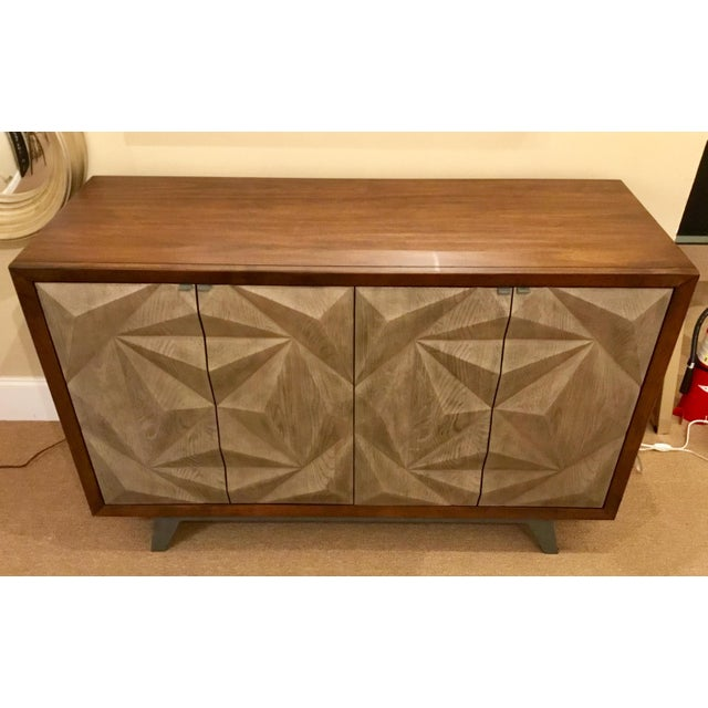 Stylish modern cabinet with taupe raised door fronts pattern, metal base with contrasting mahogany finished body, four...