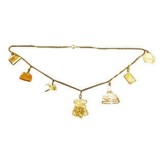 Gilt Metal Travel Theme Charm Necklace For Sale