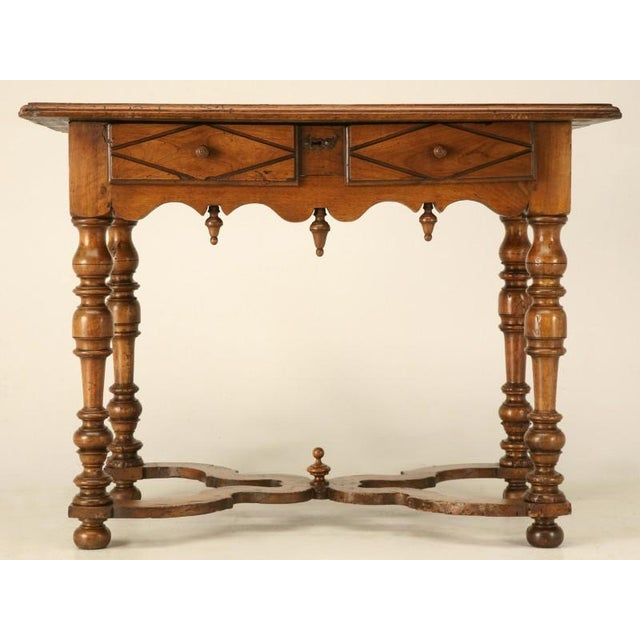 Eighteenth century French fruitwood writing table with full-width single hand-dovetailed drawer. Composed of several...