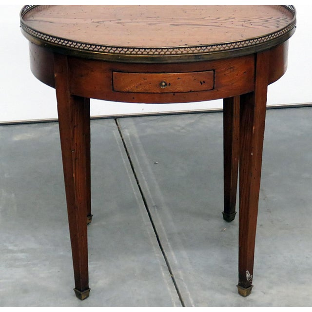 """Antique Louis XIV style bouillotte table with 2 drawers, a brass gallery, and 2 - 8.25"""" slide out extensions."""