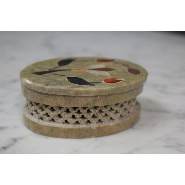 Indian green soapstone box with screen perforated sides and inlaid floral design on the lid. The piece is from the 1960s.