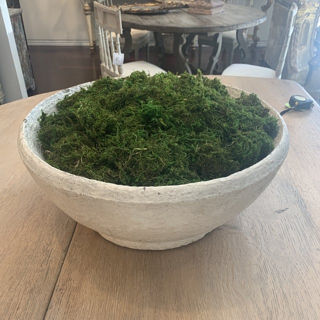 Very beautiful concrete bowl! Lots of character shown filled with moss which really adds a pop of color!