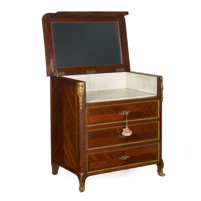 FRENCH ORMOLU MOUNTED PARQUETRY DRESSING COMMODE With marble lined and mirrored interior, circa late 19th century Item #...
