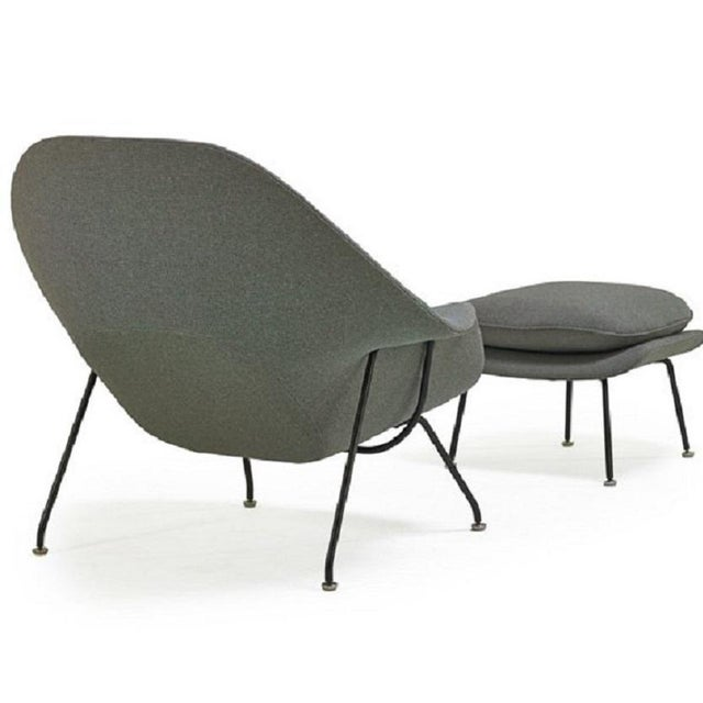 Womb chair and ottoman by Eero Saarinen for Knoll. Enameled steel frame with wool blend upholstery.