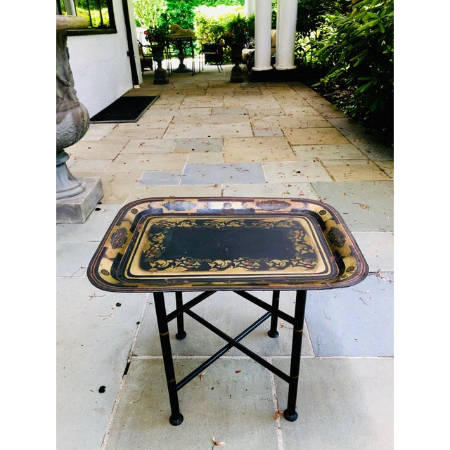 Beautifully hand stenciled early American tray table, circa 1800s. Delicately rendered motifs in gold, black, red and...