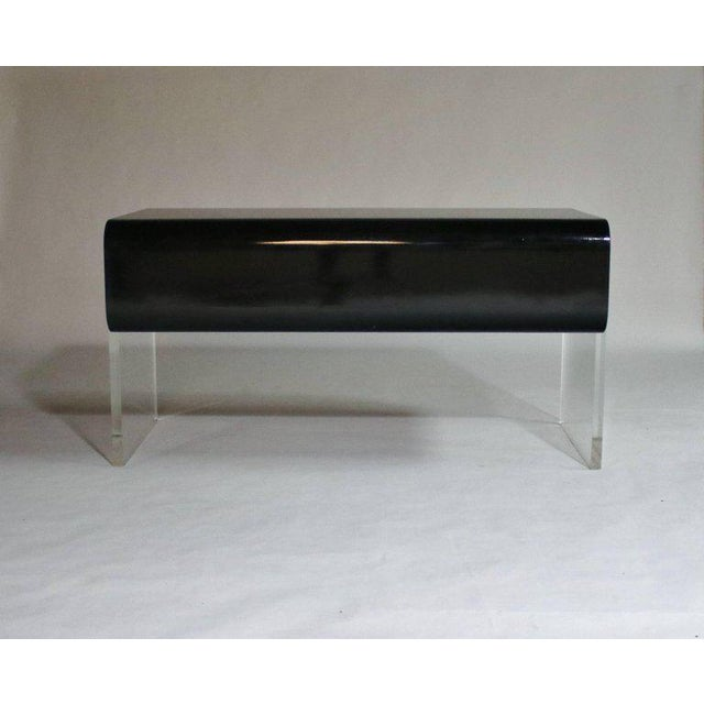 Mid-Century Modern black lacquered wood desk with four drawers floating on thick Lucite legs attributed to Pace. Unique...