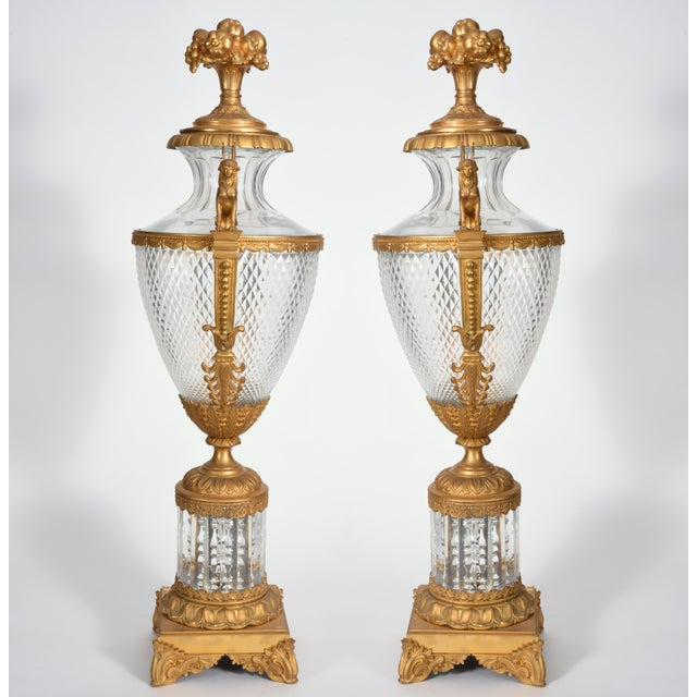 Mid-19th century very large matching pair bronze with cut glass decorative centerpiece urns. Each urn is in excellent...
