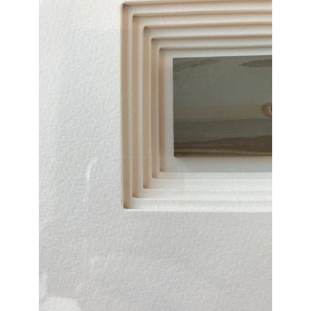 Quintuple matting of unique slices of Italian stone in a custom frame.