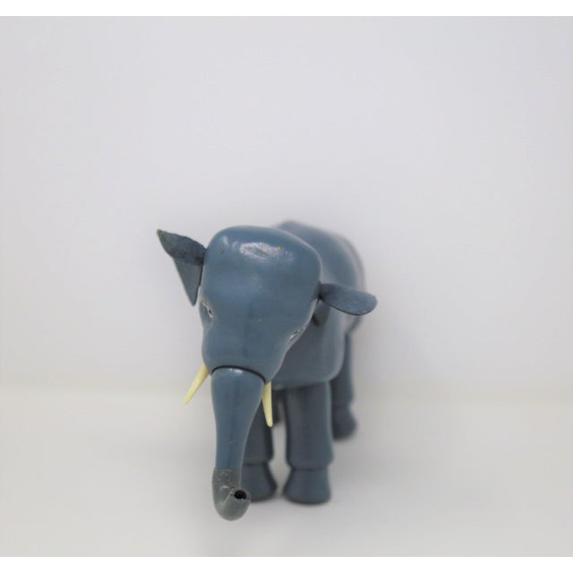 Vintage blue elephant with manipulating appendages.