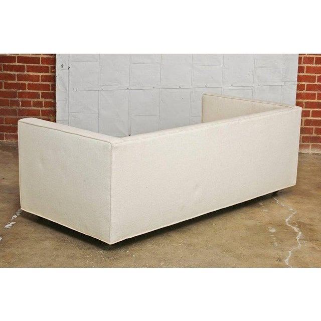 Milo Baughman style custom-made Mid Century Modern upholstered case sofa. Featuring a thick woven organic style cream...