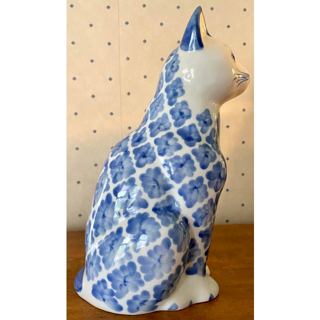 Lovely vintage ceramic cat figurine with Ikat style hand painted pattern. Little to no vintage wear and make's for a...