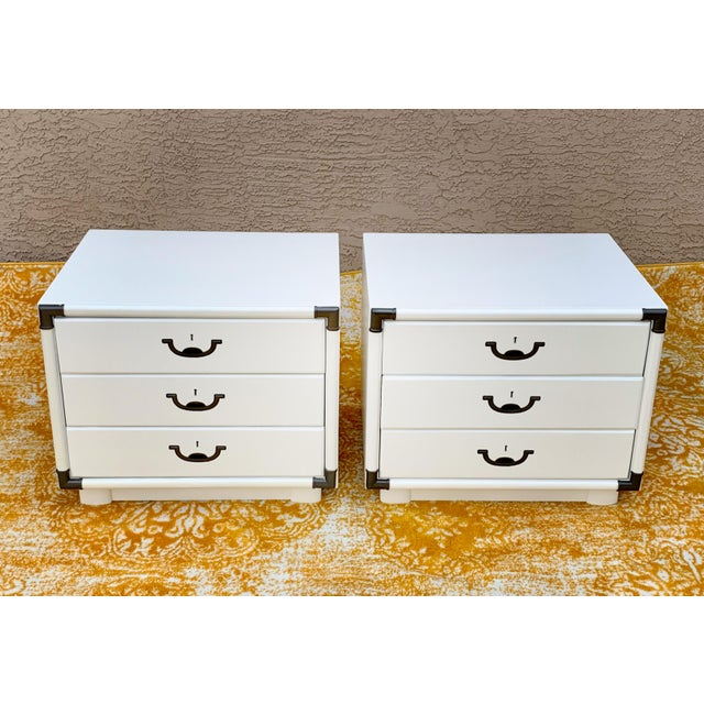 Drexel campaign style nightstands. Restored inside and out. Refinished in white. Drawers are in perfect working order.