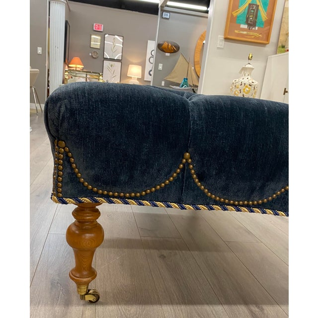 Velvet Tufted Navy Blue Ottoman on Casters W/ Nailhead and Cording Detail Great overall condition with no damages or...