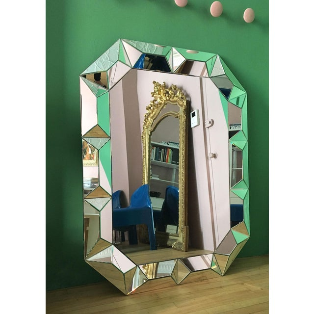 Impressive geometric cut surround wall mounted mirror, made in Italy Note: two small blemishes pictured in the last two...
