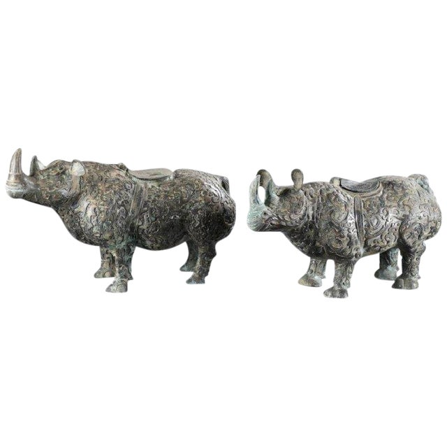 Chinese Bronze Rhinoceros Statues With Decorative Relief Pattern - a Pair For Sale