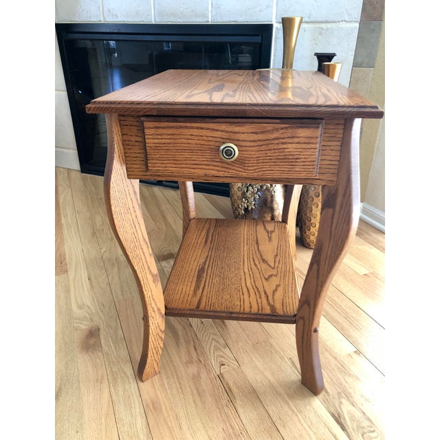 This lovely, rather unique table, was built by a local/regional Amish craftsman. It is 100% solid oak wood and it has been...