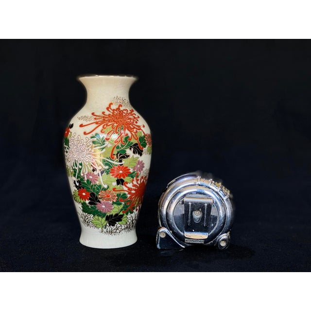 A Porcelain Floral Motif Crackle Finish Vase, Japan, c. Mid 20th Century. This Vase would look exceptional while on...