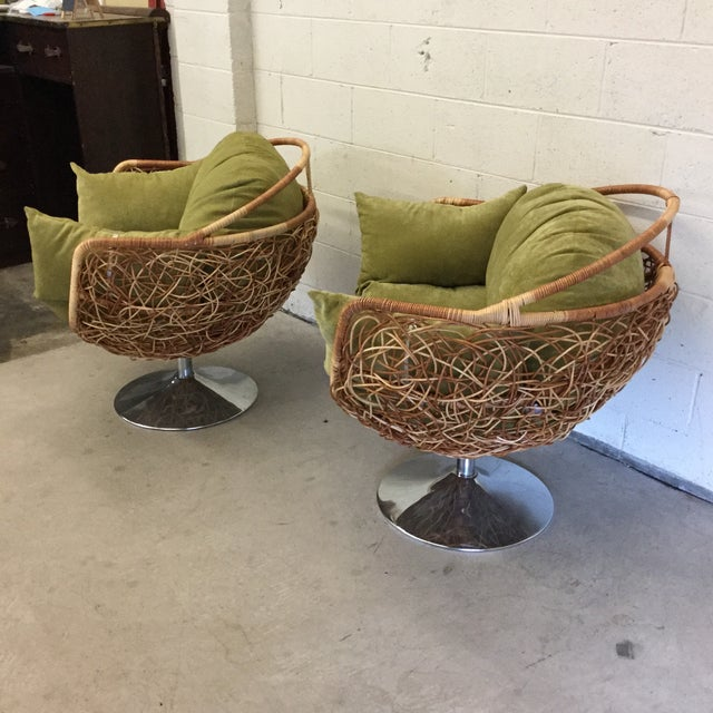 Get your beach or river house open and freshened up! Fun pair of wicker pod chairs on chrome tulip-style base. Chairs...
