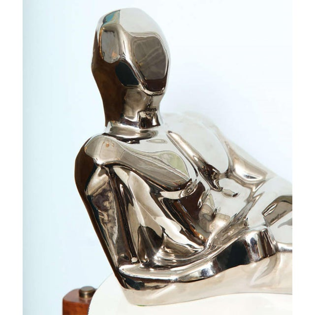 Jaru circa 1970s. Ceramic silver sculpture of figure laying back.