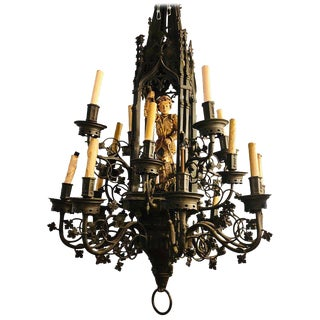 Palace Sized Wrought Iron Chandelier With a Gilt Carved Wooden Figure of a Man For Sale