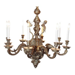Ornate 19th Century French 8-Light Bronze Chandelier With Cherubs and Faces For Sale
