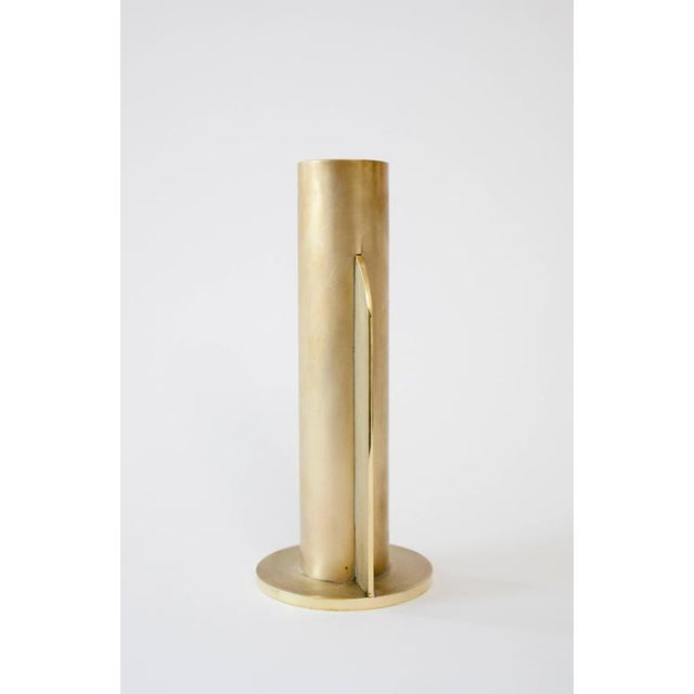 This contemporary vase made of brushed brass is part of the Orphan Work brand and can be used as an table top object....
