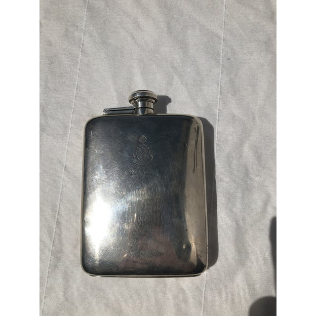 Sterling silver flask dated 1922. This piece has been kept in great condition and measures 4.25 inches in width and 6...