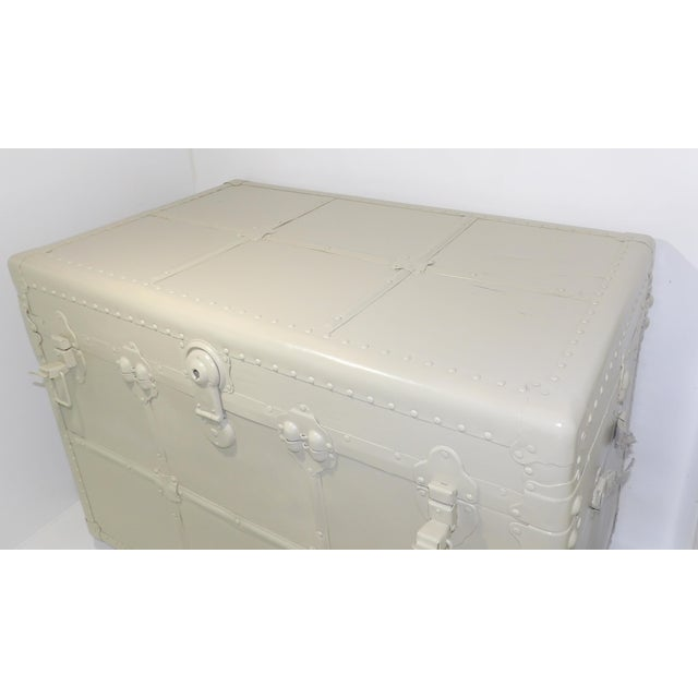 Gorgeous antique steamer trunk from early 1900's . Has been restored with Tan Beige Satin Finish. Gorgeous original paper...
