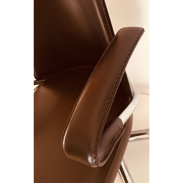 """""""Luna"""" brown leather office chair by Martino Perego is the contemporary answer to the desk chair. The seat and back are..."""