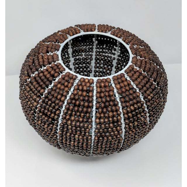 Made from painted white metal and wooden beads that have been stained with a beautifully rich chocolate color, this vase...