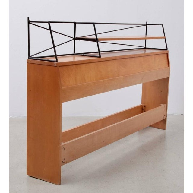 Rare wrought iron Paul McCobb headboard in solid maple. Signed and in very good condition.