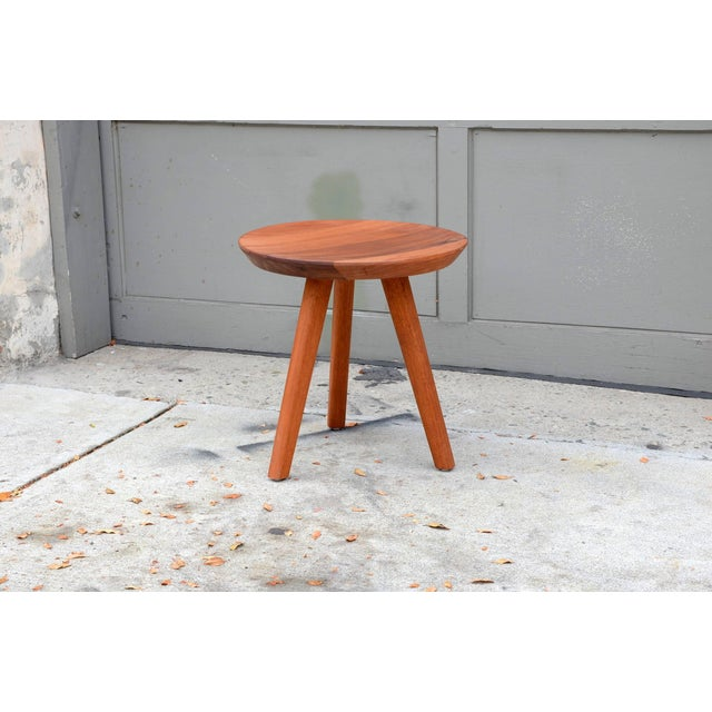 Pair of sturdy tripod carved wood stools in the style of Charlotte Perriand.