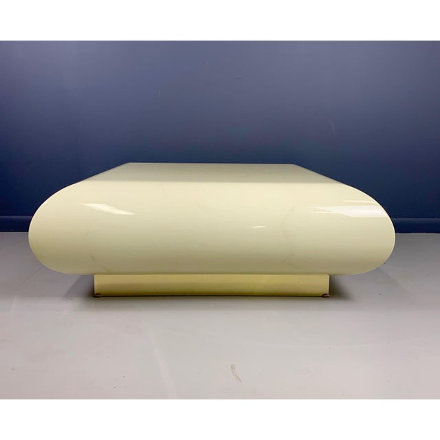This incredible coffee table designed in the 1990s with a brass base designed in the manner of Karl Springer is a...