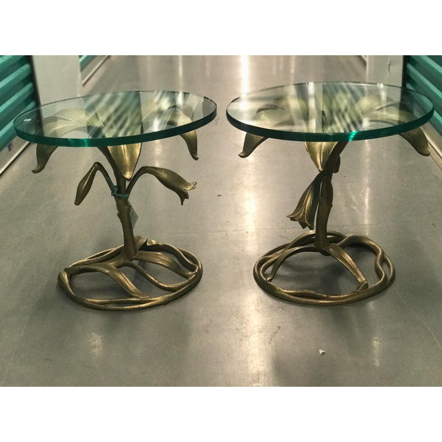 Pair of vintage Arthur Court metal Lily side tables with glass tops. Materials include forged metal, forged aluminum,...