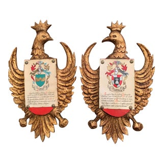 Early 20th Century Spanish Carved Giltwood and Polychrome Wall Shields - a Pair For Sale