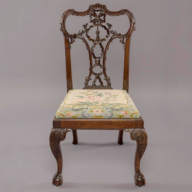 Set of eight circa 1860s finely carved English mahogany Chinese Chippendale chairs. Two arm chairs and six side chairs....