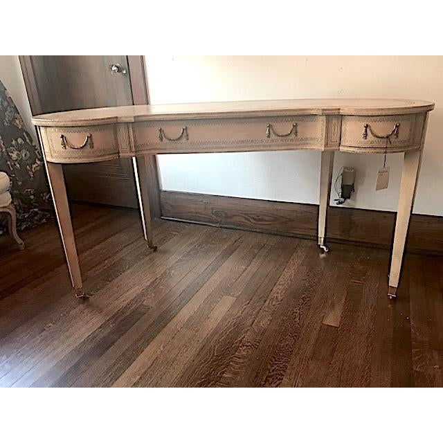 Fabulous French cream colored Maitland Smith kidney shaped desk with inset leather top and legs. The desk has 3 drawers,...