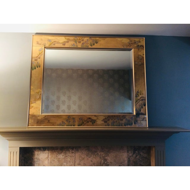 Highly sought-after La Barge mirror with reverse painted glass panels (Eglomise). This prized possession from a Bel-Air,...