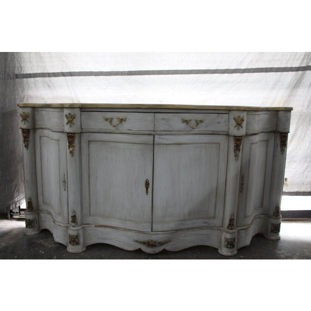 Vintage 20th century French long console. Distressed white oak wood finish with gold detailing and handles. Great...