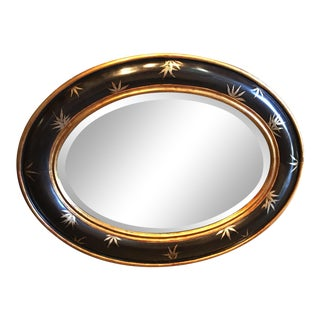 Vintage Chinoiserie Gold Bamboo Leaves on Convex Black Frame With Antiqued Oval Smoky Mirror For Sale